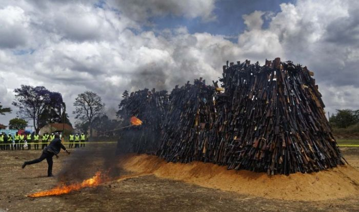 Kenyan Police Burn Thousands Of Illegal Weapons