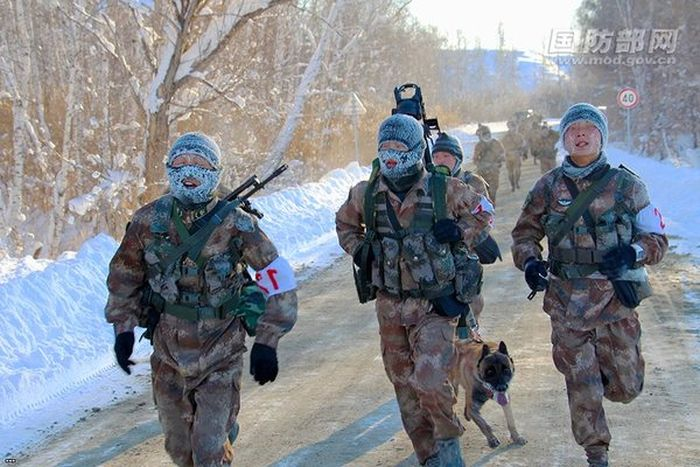 Chinese Soldiers Run While Covered In Frost