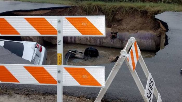 Massive Sinkhole Swallows Two Cars In Texas