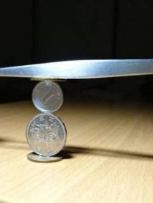 Japanese Guy Takes Coin Stacking To The Extreme