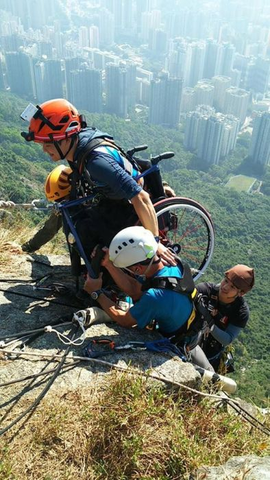 Strong Man In A Wheelchair Climbs A Mountain In China