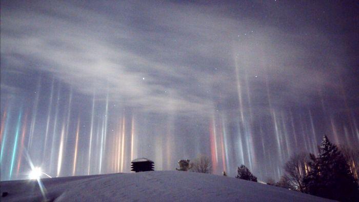 Phenomenon Known As Light Pillars Illuminates Ontario Night Sky