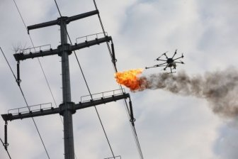 Power Company Uses Drone To Burn Trash Off High Voltage Wires