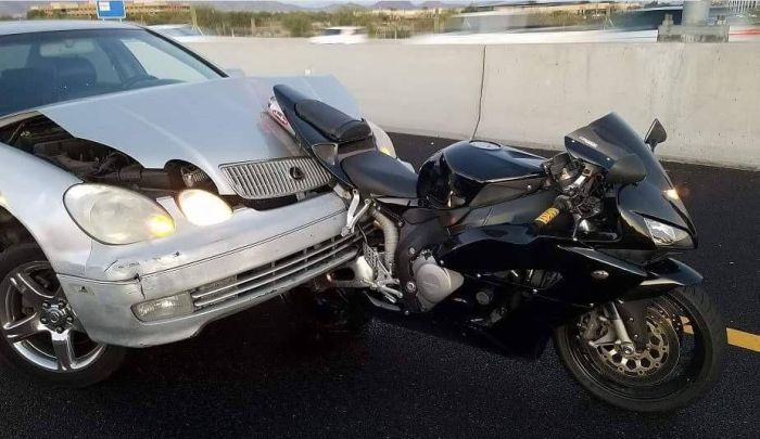 Car Takes On A Motorcycle And Loses