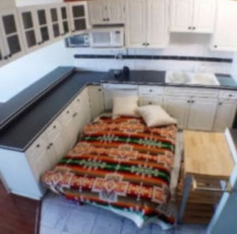 Weird Apartment Listing Uses Double Bed For Scale