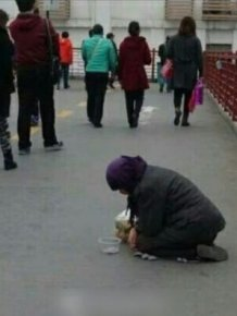 See What This Beggar Does When She's Handed Food