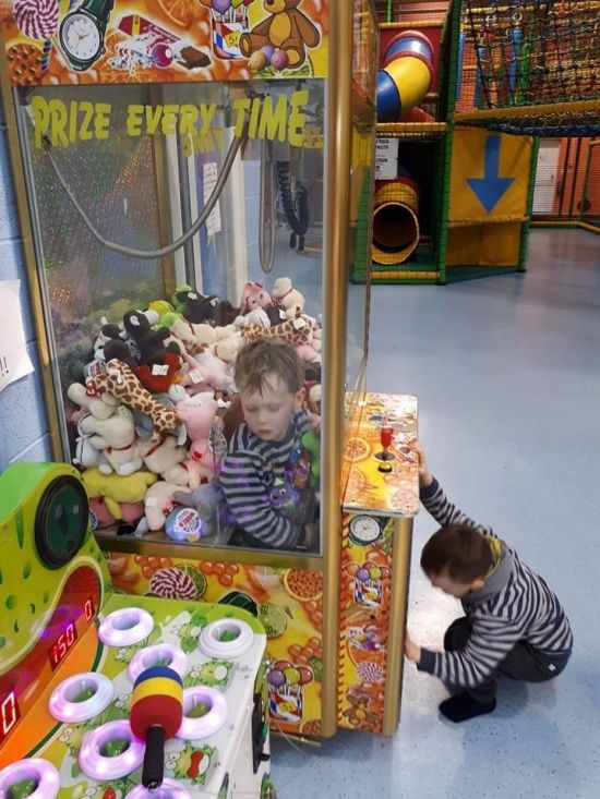 Kid Gets Extra Prizes After Getting Stuck In The Machine