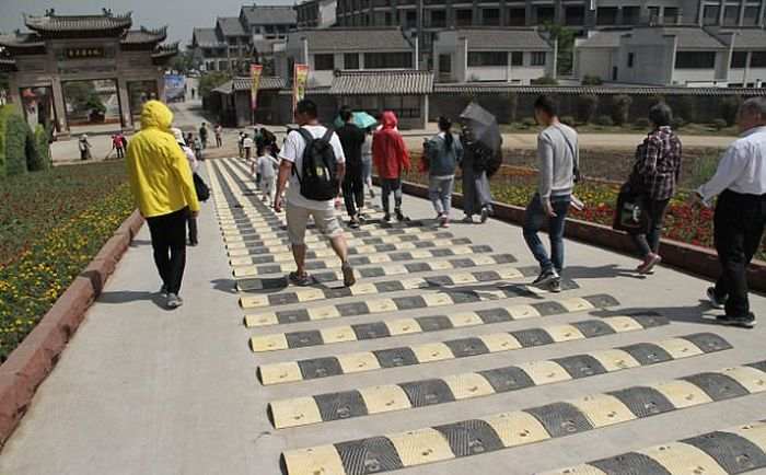 Chinese Tourist Attraction Adds Ridiculous Speed Bumps For Pedestrians