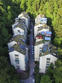This Residential Complex Is Tucked Away In A Natural Sea Of Green