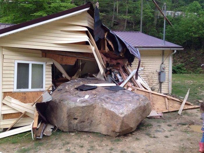 Sliding Boulder Collides With A House