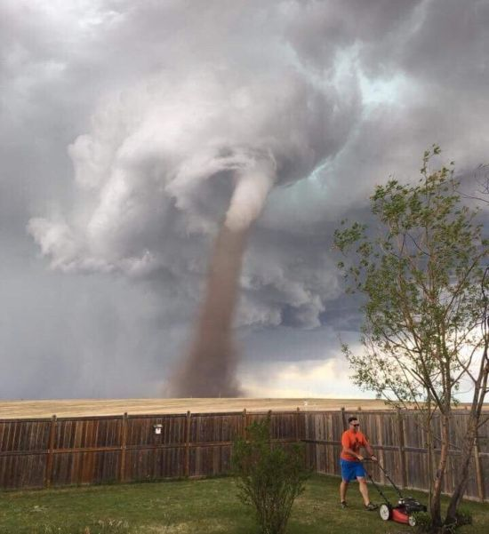 Canadian Man Shows No Fear By Mowing Lawn During A Tornado