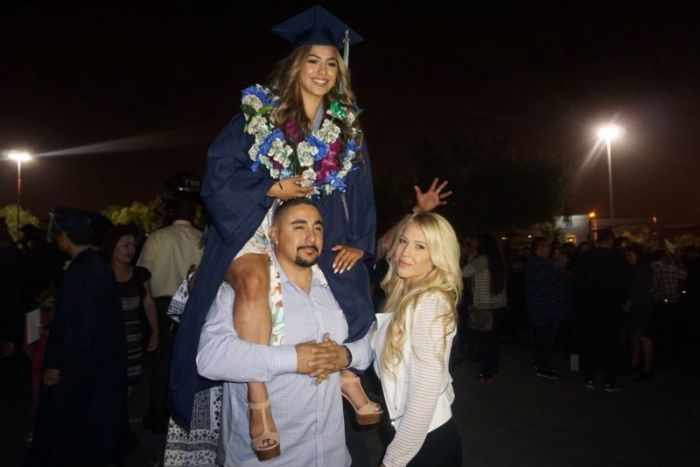 Parents Recreate Graduation Photo With Their Daughter