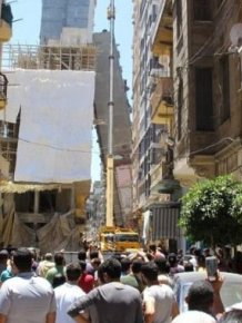 High Rise Building Falls Into A House In Egypt