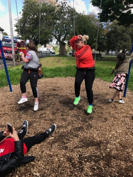 Aunt And Niece Get Stuck In Children's Swing