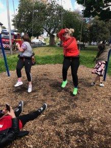 Aunt And Niece Get Stuck In Children's Swing