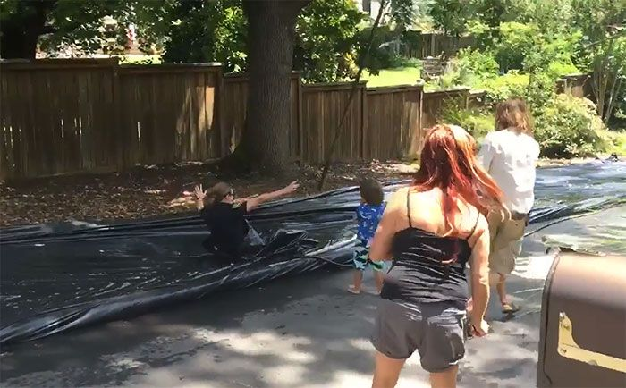 Police Slide Down Illegal Slip 'N Slide Instead Of Shutting It Down