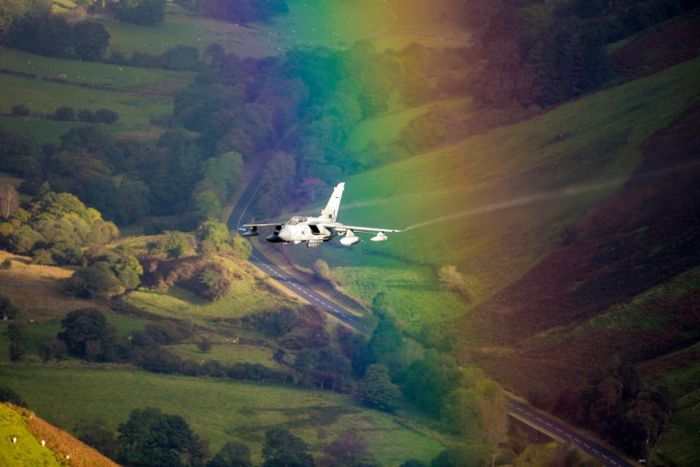 Incredible Photo Captures Jet Flying Through A Rainbow