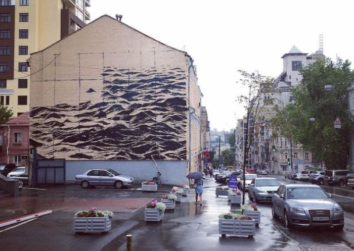 Ferocious Black Sea Covers The Wall Of A Three Story Building