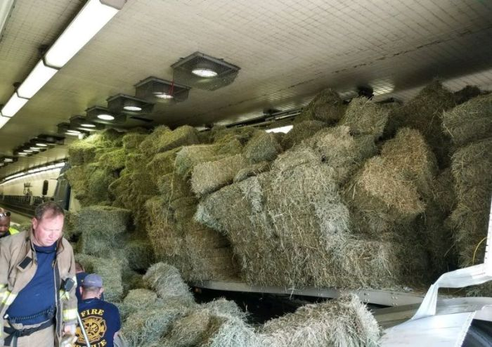 Truck Loaded With Hay Gets Stuck In A Tunnel