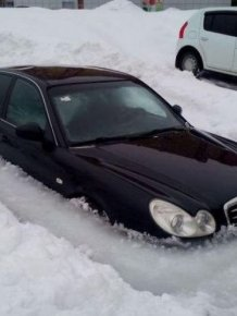 Car Stuck In Ice In Russia