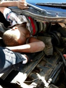 Migrants Hiding Underneath A Car's Bonnet And Seats