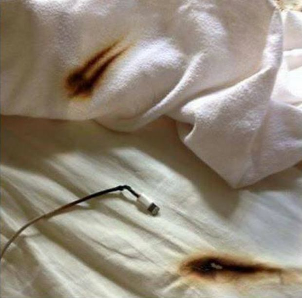 Why You Shouldn't Charge Your Phone On Your Bed