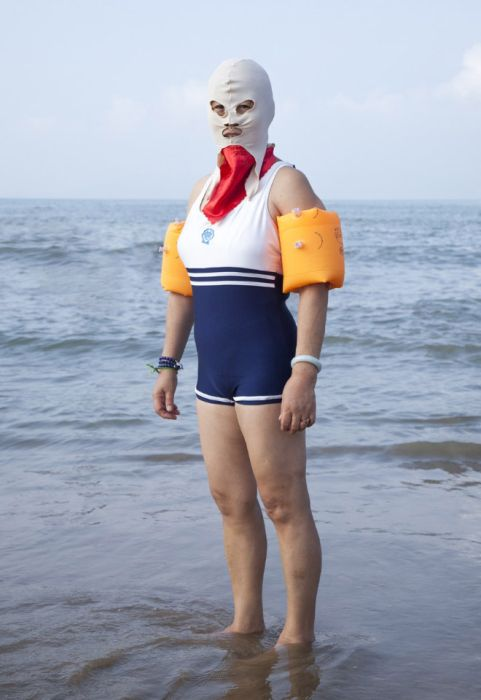 Chinese Use These Swimsuits To Keep Their Skin White