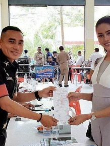 Thai Ladyboys Pose With Certificates That Exempt Them From Army Service