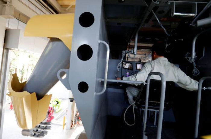 Japanese Engineer Builds Large Robot With A Gun