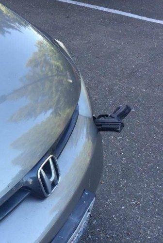 Flying Gun Hits A Car On I-5