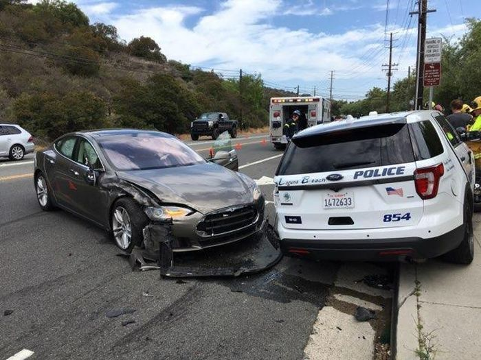 Tesla Autopilot Smashed Parked California Police Ford