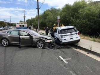 Tesla Autopilot Smashed Parked California Police Ford