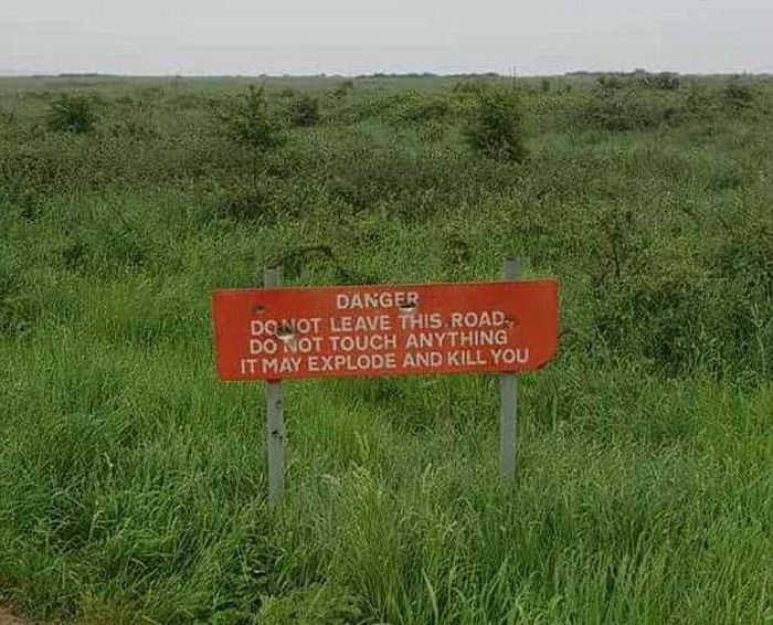 'Deadly manure gases possible!' Tourists share the VERY alarming road signs they've spotted around the world