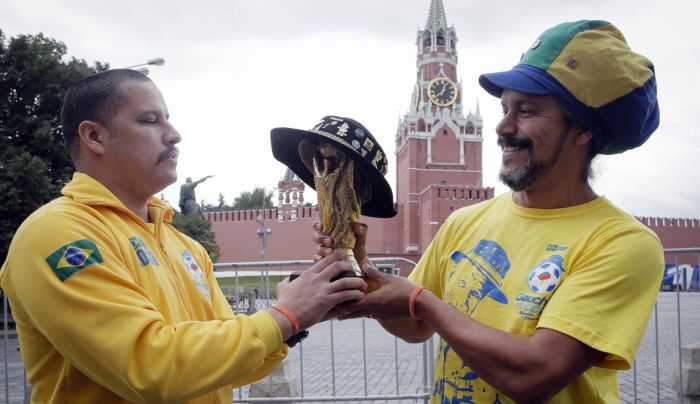 The Two Sons Of The Famous Brazilian Fan That Died in 2015 Took His Trophy And Hat To Russia