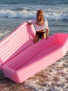A Pink Coffin Pool Float With Lid
