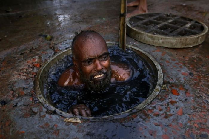 What A Job. This Guy Cleans Sewage In Bangladesh