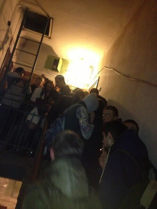 People Hanging Around In Russian Apartment Buildings