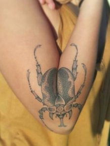 Woman's Beetle Tattoo Spreads Its Wings When She Extends Her Arm