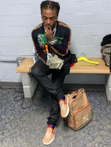 Rapper  Jacquees Gives Two bags Stuffed With $100,000 As Wedding Gift To His Mother