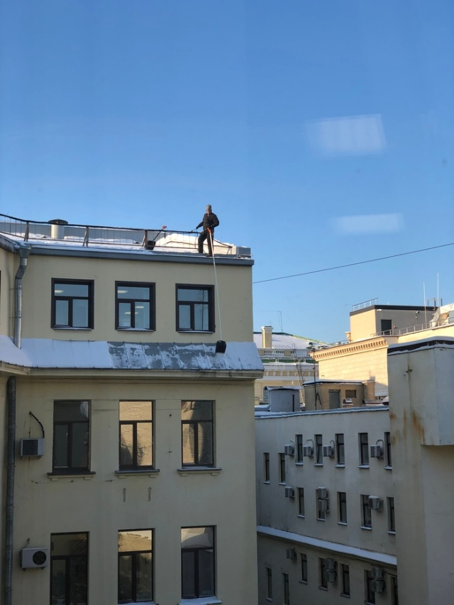Snow Removal From Roofs In Russia