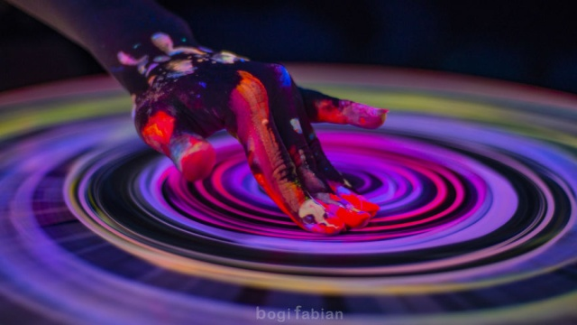 A Hypnotizing Potter's Wheel Under Ultraviolet Light