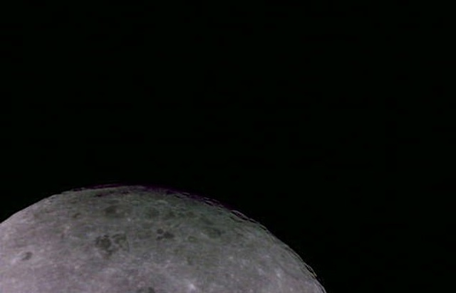 The Far Side Of The Moon With Earth Sitting In The Distance
