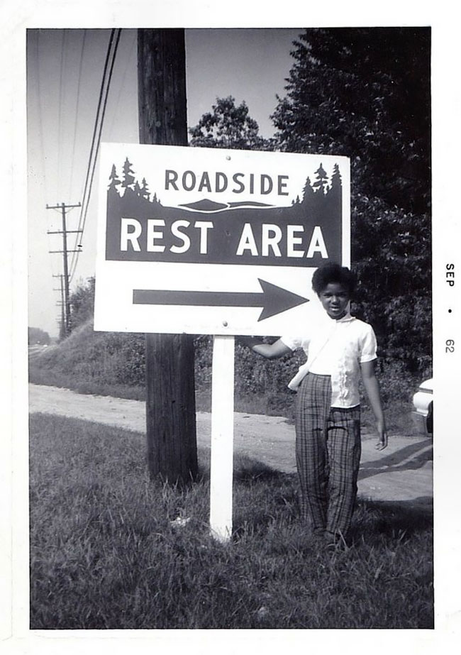 People Posing With Signs Many Years Ago