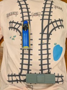 Japanese Dad Designs A T-Shirt With A Train Track So His Son Would Give Him A Massage While Playing
