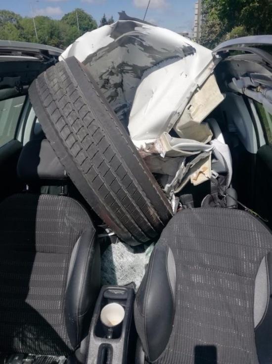 A HGV Wheel Smashes Through A Car Windscreen. The Driver Walks Away