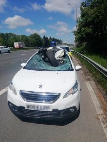 A HGV Wheel Smashes Through A Car Windscreen. The Driver Walks Away
