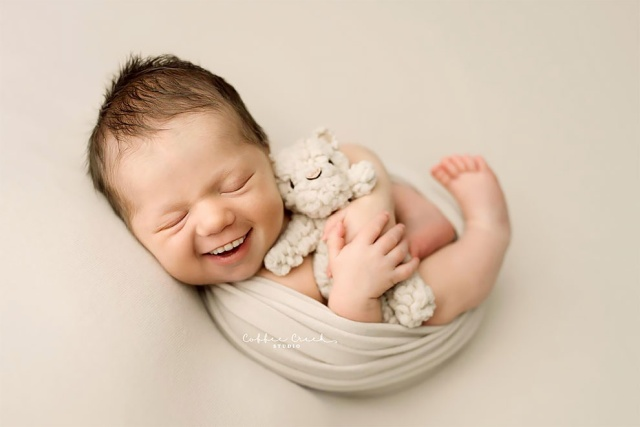 Photographer Adds Smiles On Professional Baby Photos