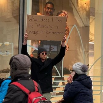 Guy With A Sign Shows Off Funny Statements