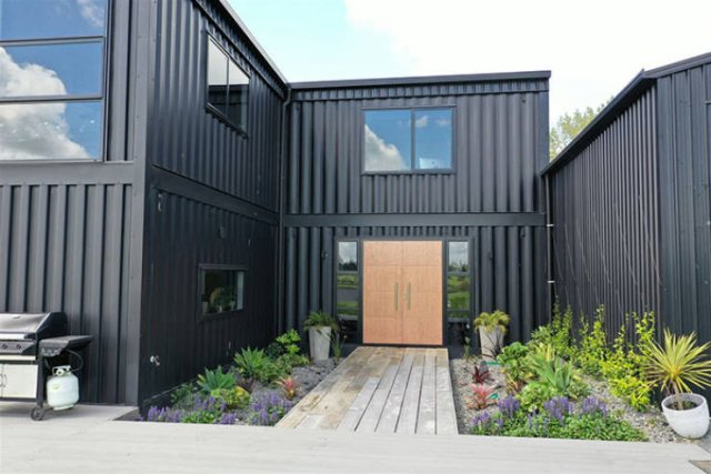 This Wonderful House Is Built Out Of 12 Shipping Containers