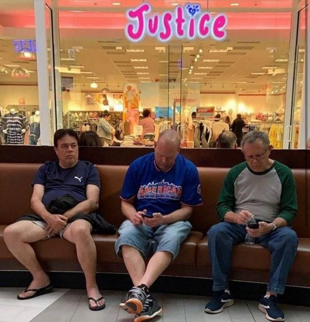 Men Shopping With Their Wives